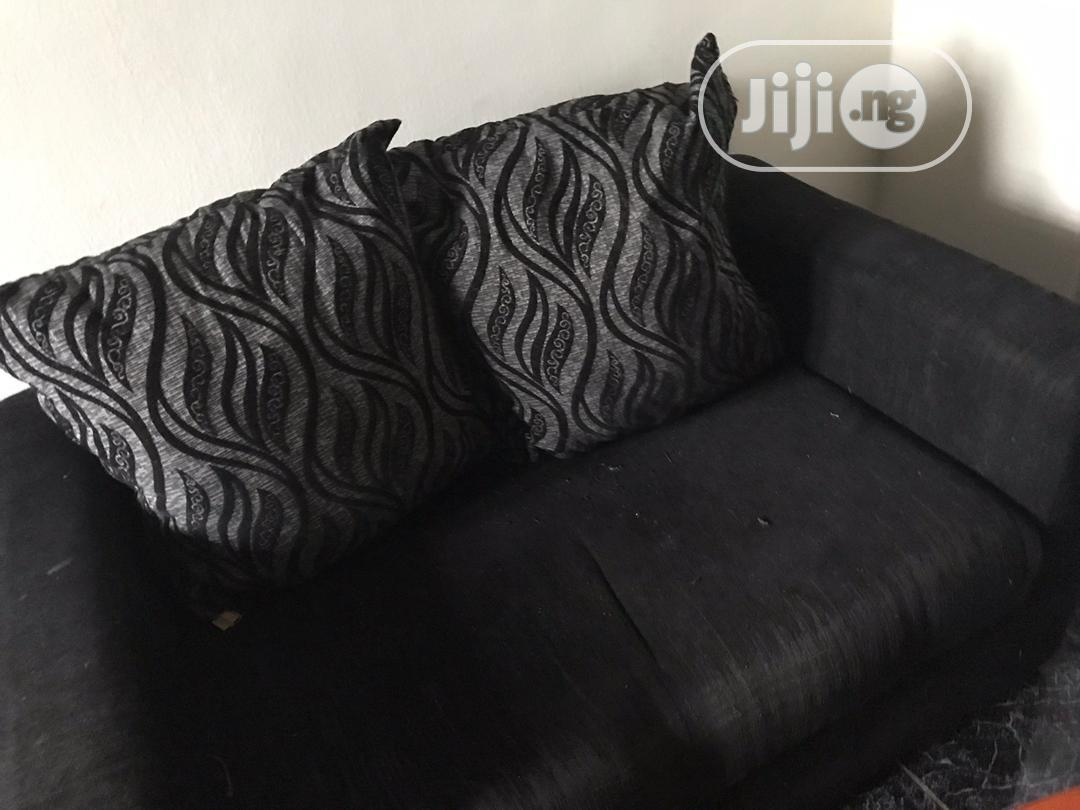 Picture of: Archive Two Seater Sofa With Two Big Throw Pillow With Table In Ajah Furniture Adegoke Adeyemi Jiji Ng For Sale In Ajah Adegoke Adeyemi On Jiji Ng