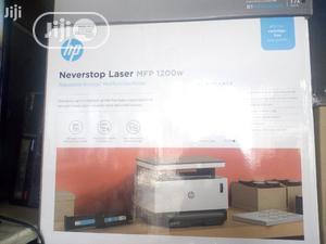 HP Laser 1200w Wireless Printer - Print Scan. Copy | Printers & Scanners for sale in Lagos State, Ikeja