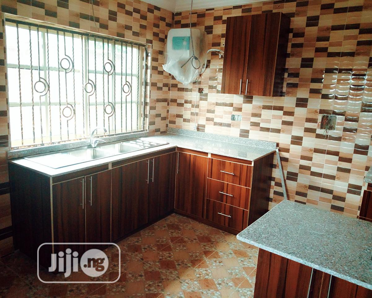 Kitchen Cabinets In HDF Material With Marble Top
