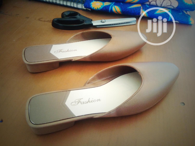 Archive: Flat Quality Rubber Fancy Ladies Half Shoe