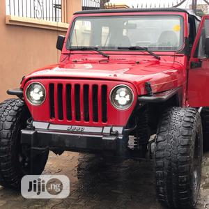 Jeep Wrangler 1998 Red | Cars for sale in Lagos State, Ikeja