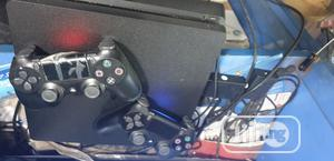 Ps4 Slim Console With 2 Controllers & Fifa 20 Cd | Video Game Consoles for sale in Lagos State, Ikeja