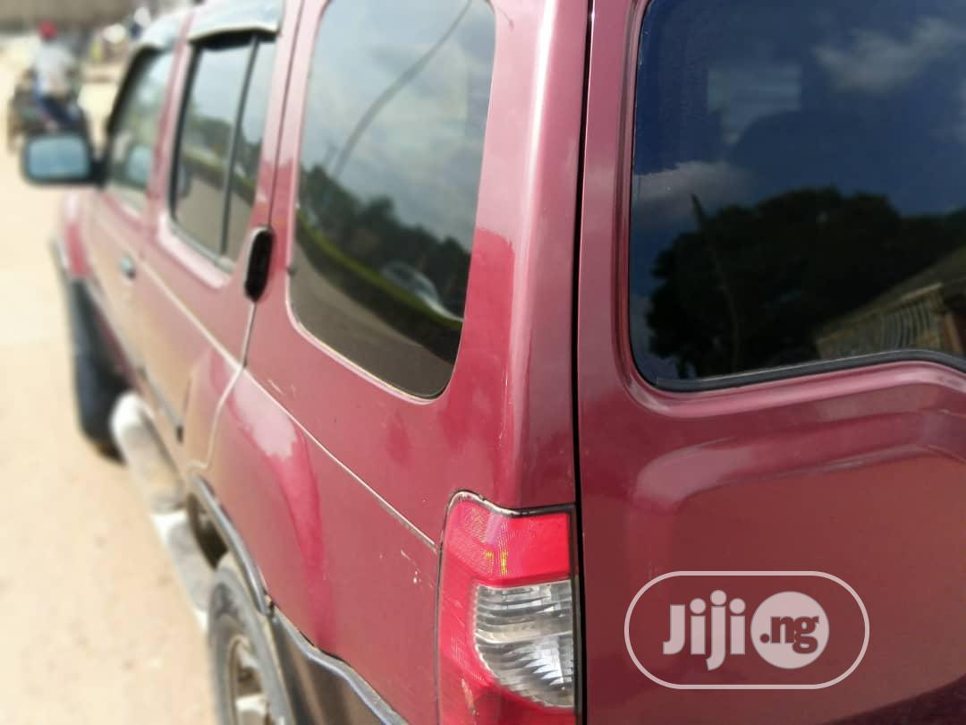 Archive: Nissan Xterra 2004 XE 4x4 Red