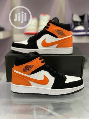 Original Nike Air Jordan 1(Mid Black White Starfish Orange)   Shoes for sale in Lagos State, Lagos Island (Eko)