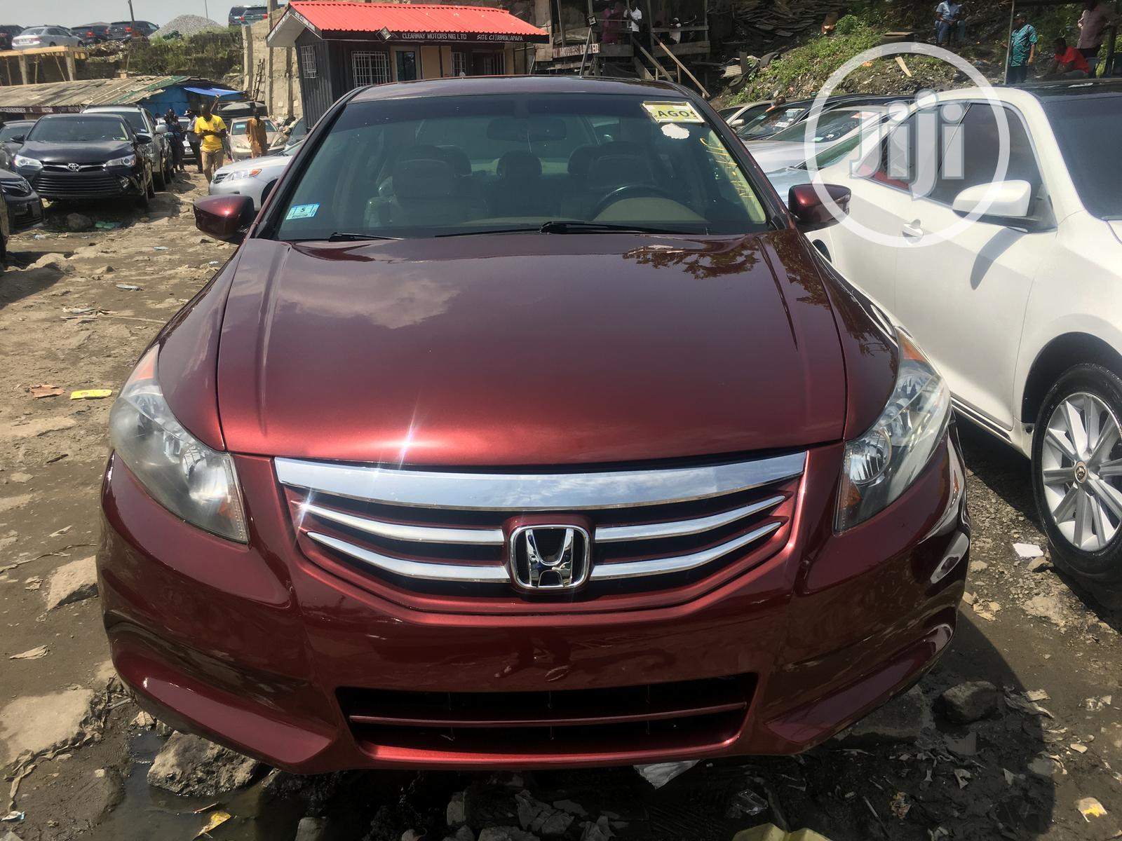 Archive: Honda Accord Coupe EX-L V6 Automatic 2009 Red