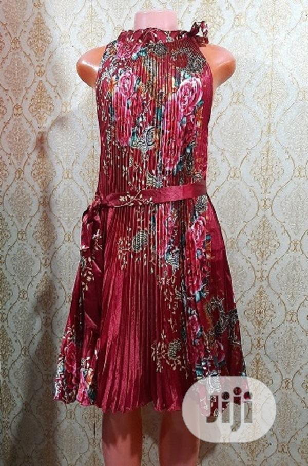 Ladies Pleated Satin Short Gown With Lovely Flower Design | Clothing for sale in Surulere, Lagos State, Nigeria