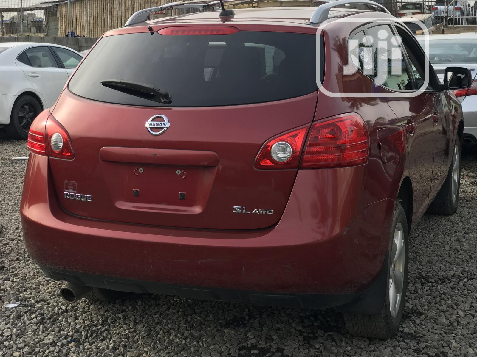 Archive: Nissan Rogue 2009 SL 4WD Red
