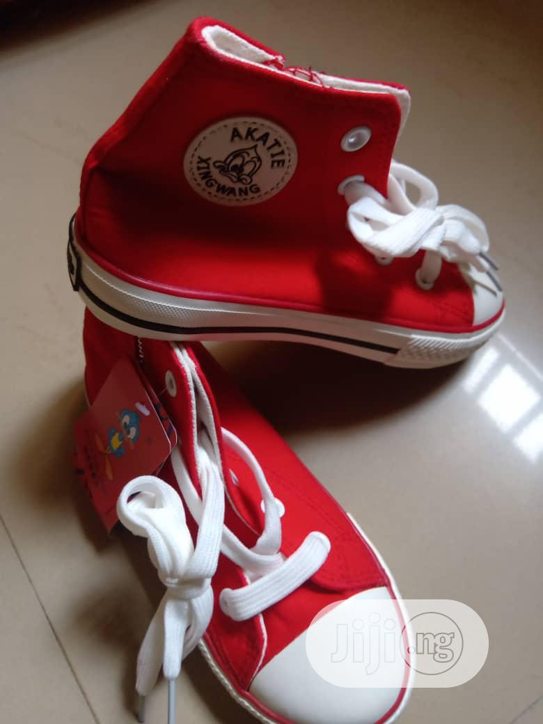 Archive: Kids Red Sneakers