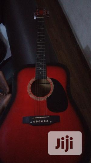 Red Jumbo Guitar With Army Bag | Musical Instruments & Gear for sale in Lagos State, Surulere