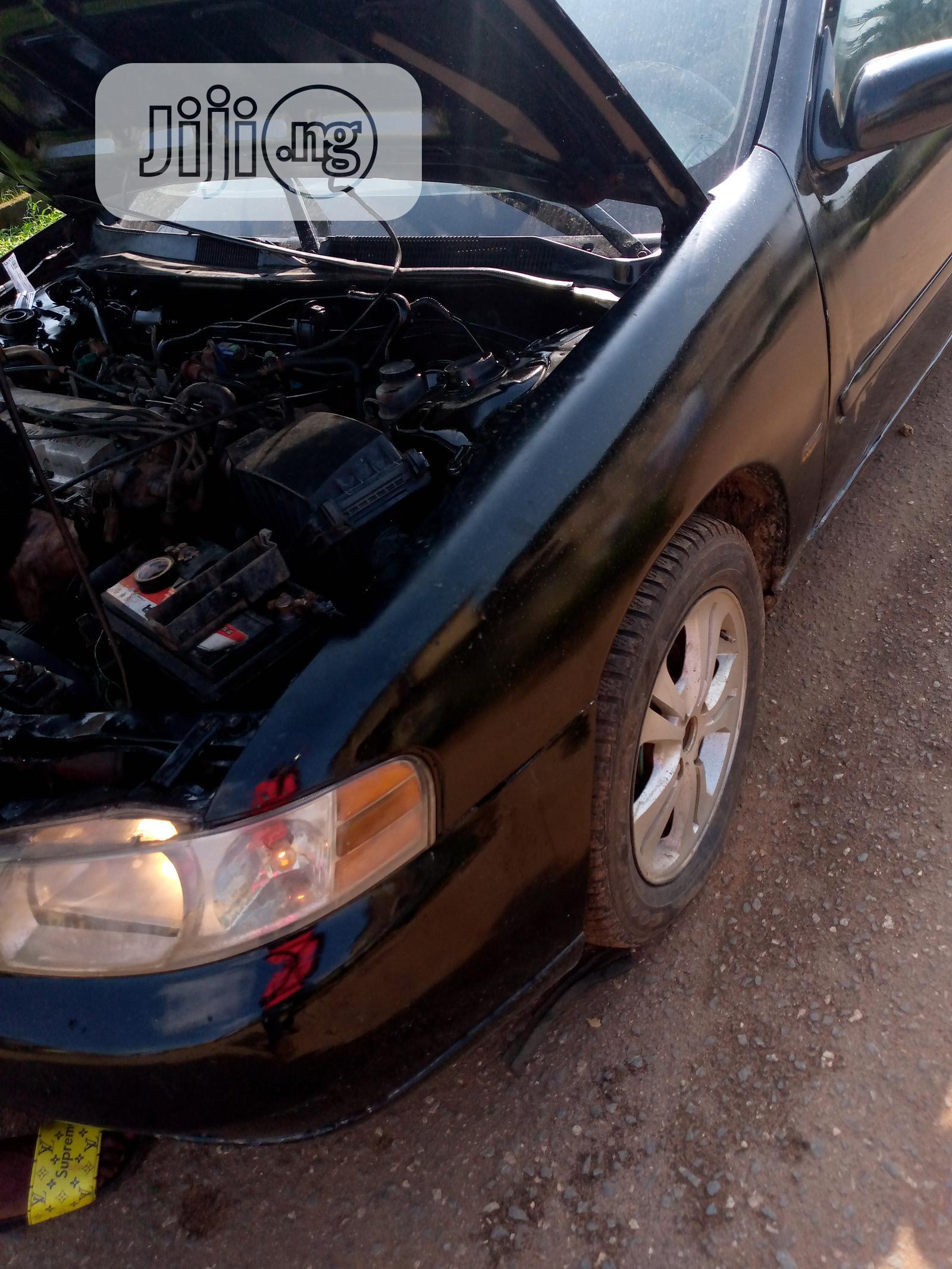 Archive: Nissan Altima 2000 GXE Black