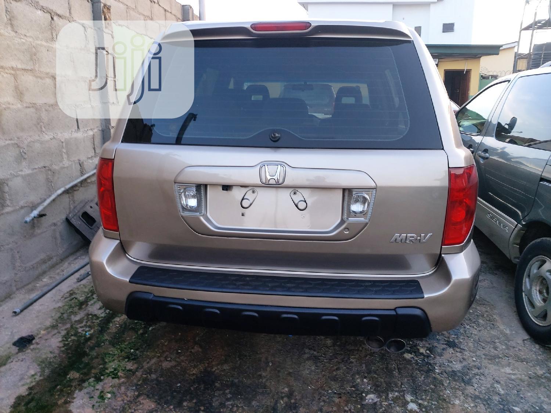 Honda Pilot 2004 EX-L 4x4 (3.5L 6cyl 5A) Gold | Cars for sale in Ifako-Ijaiye, Lagos State, Nigeria