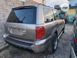 Honda Pilot 2004 EX-L 4x4 (3.5L 6cyl 5A) Gold | Cars for sale in Lagos State, Ifako-Ijaiye
