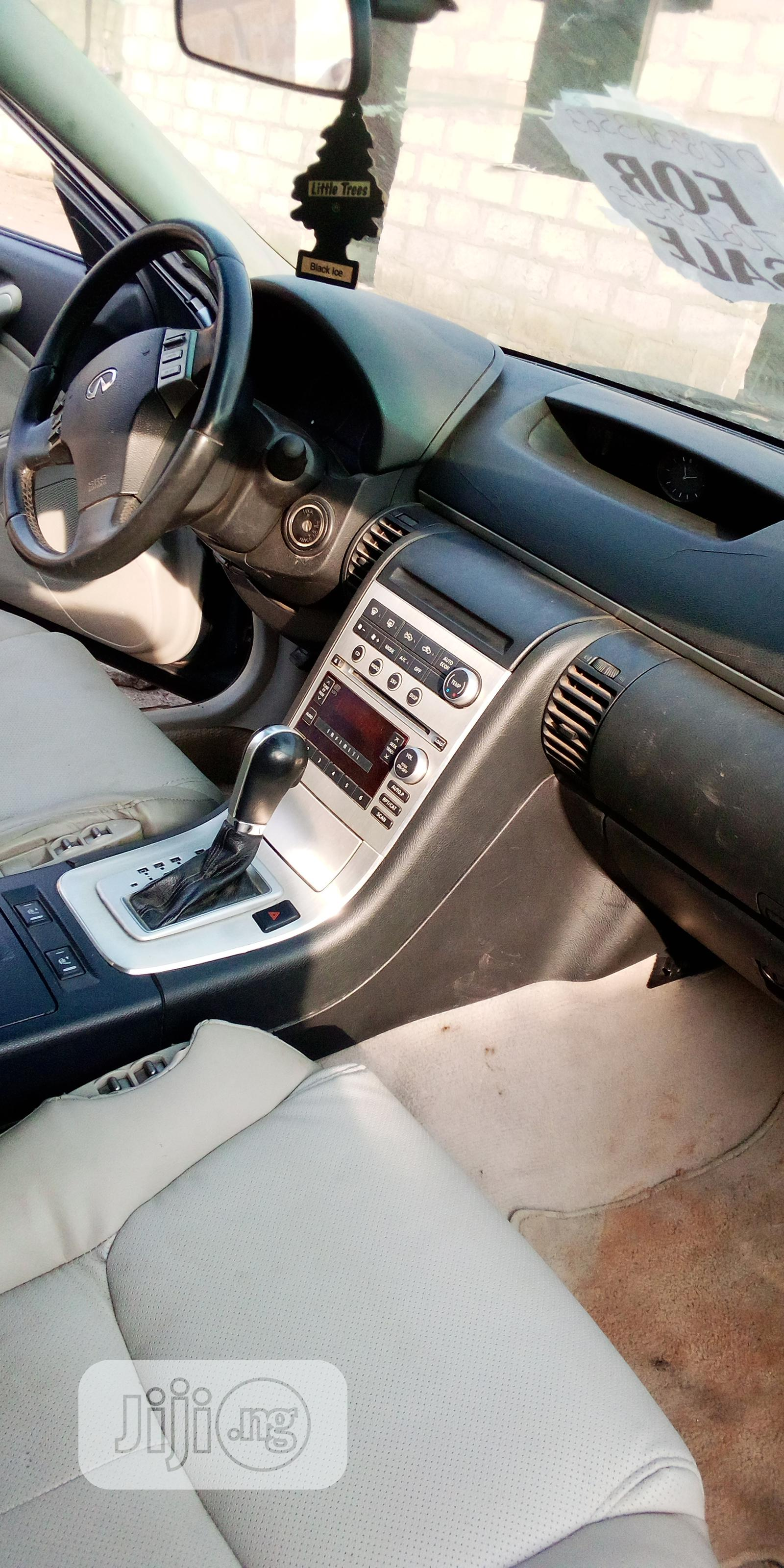 Archive: Infiniti G35 2004 Base W/Leather Coupe Blue