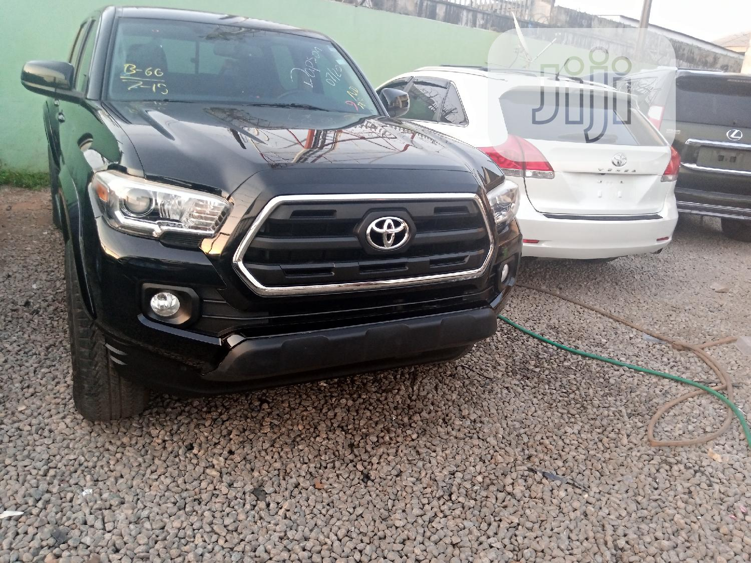 Toyota Tacoma 2016 4dr Double Cab Black | Cars for sale in Ibadan, Oyo State, Nigeria