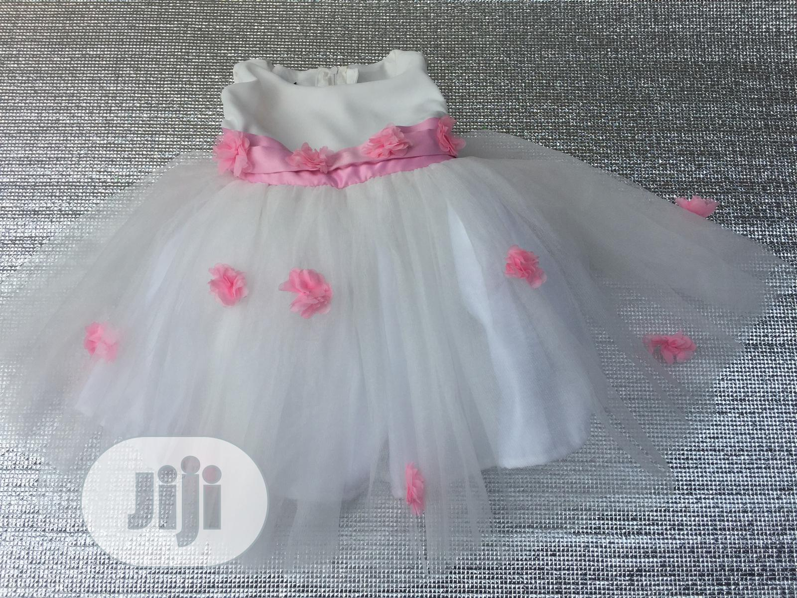 Off White Ball Dress With Baby Pink Flowers And Belt | Children's Clothing for sale in Gbagada, Lagos State, Nigeria