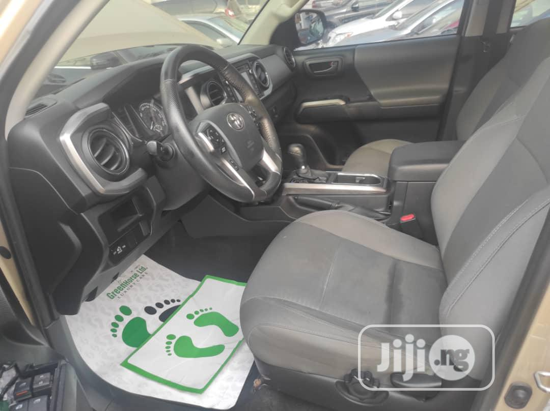 Toyota Tacoma 2016 4dr Double Cab Gold | Cars for sale in Ikeja, Lagos State, Nigeria