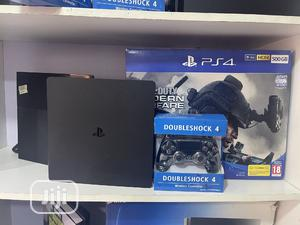 Slim Ps4 Consoles+ Accessories + Games | Video Game Consoles for sale in Abuja (FCT) State, Central Business Dis
