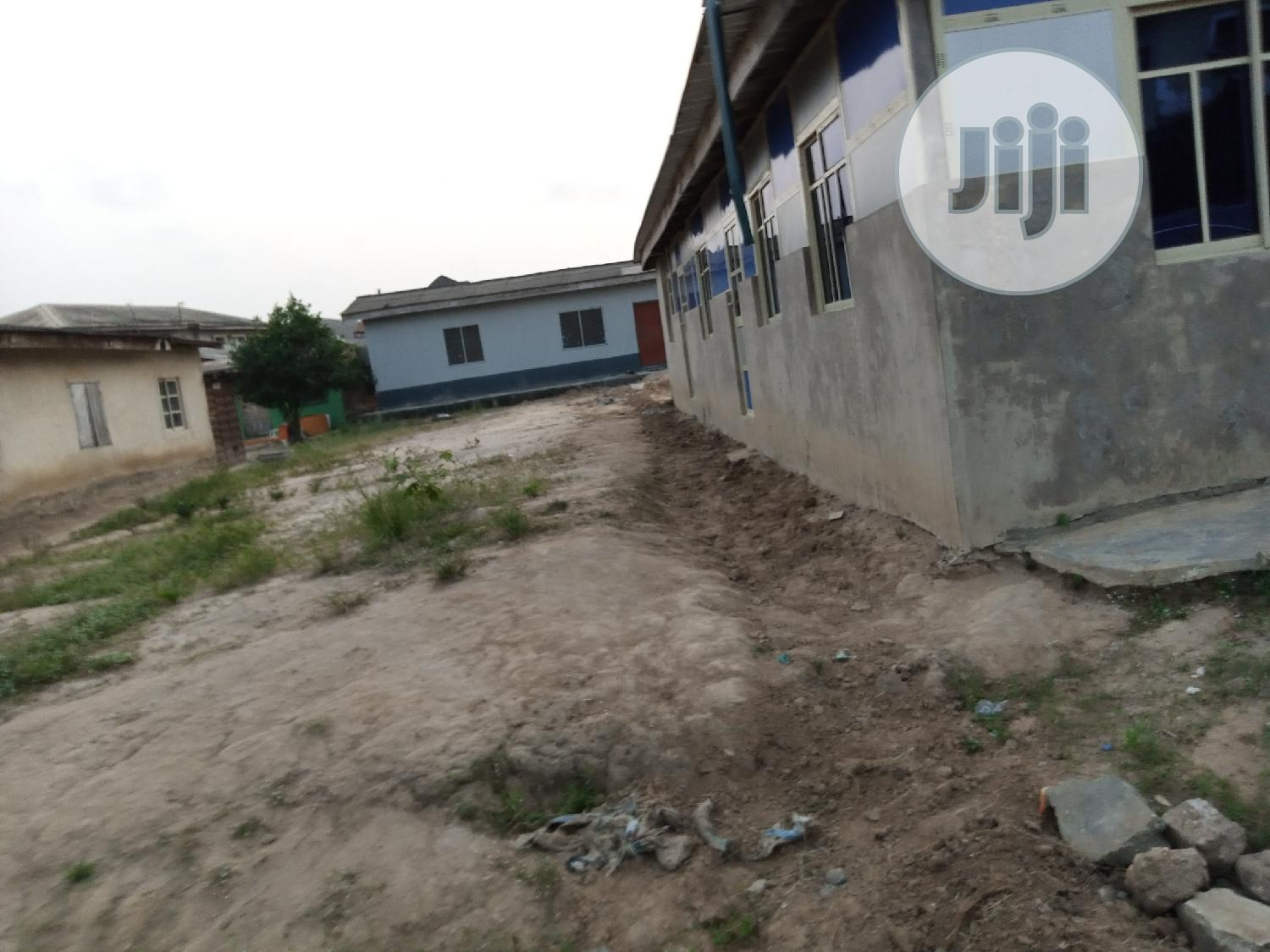 Half Plot of Land With for Sale With 3bedroom Flat for Sale.