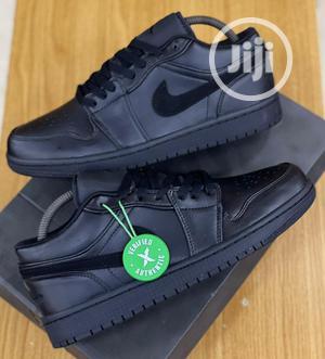 Nike Air Jordan 1 Low Triple Black Sneakers Original   Shoes for sale in Lagos State, Surulere
