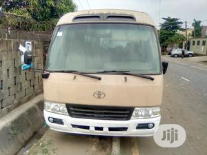 Toyota Coaster 2009 Beige | Buses & Microbuses for sale in Lagos State, Ikeja