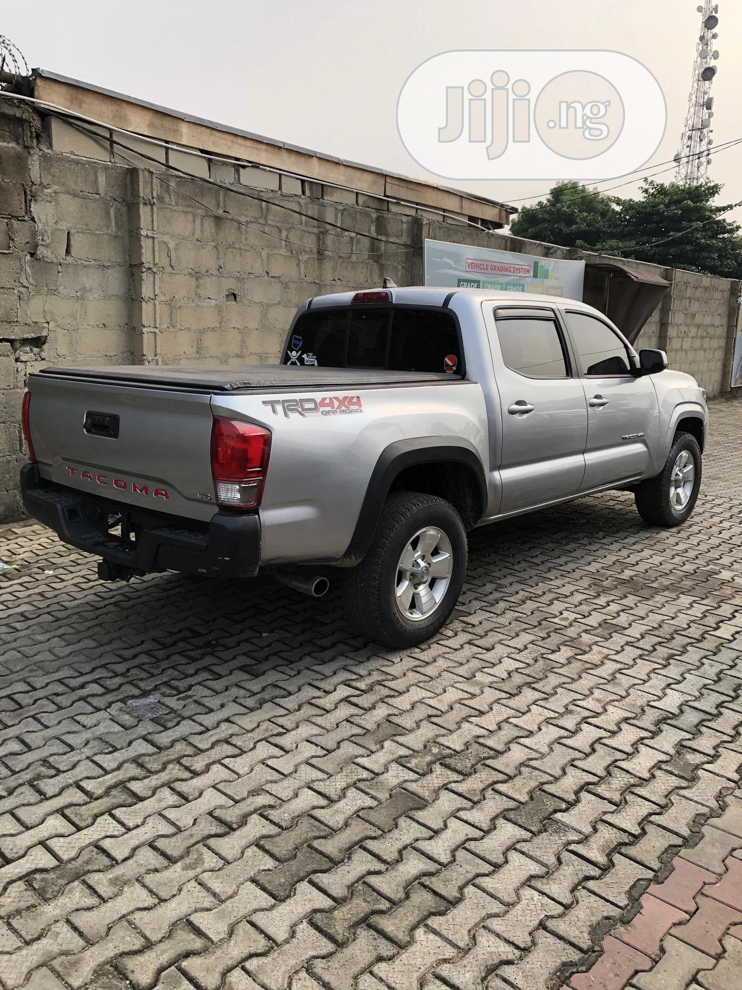 Toyota Tacoma 2016 4dr Double Cab Silver | Cars for sale in Magodo, Lagos State, Nigeria