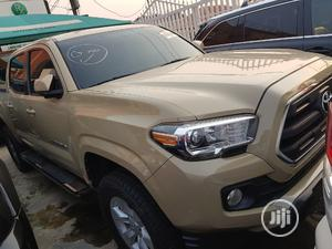 Toyota Tacoma 2016 4dr Double Cab Beige | Cars for sale in Lagos State, Ifako-Ijaiye