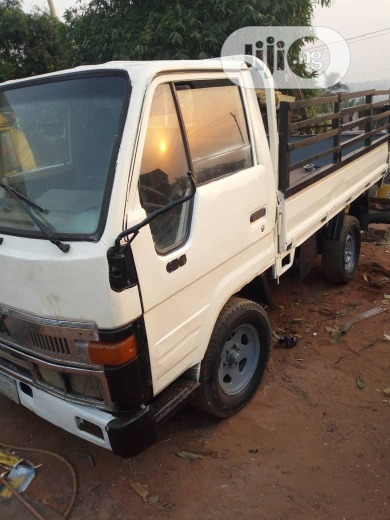 Neat Toyota Dyna 150 1999 White For Sale | Trucks & Trailers for sale in Onitsha, Anambra State, Nigeria