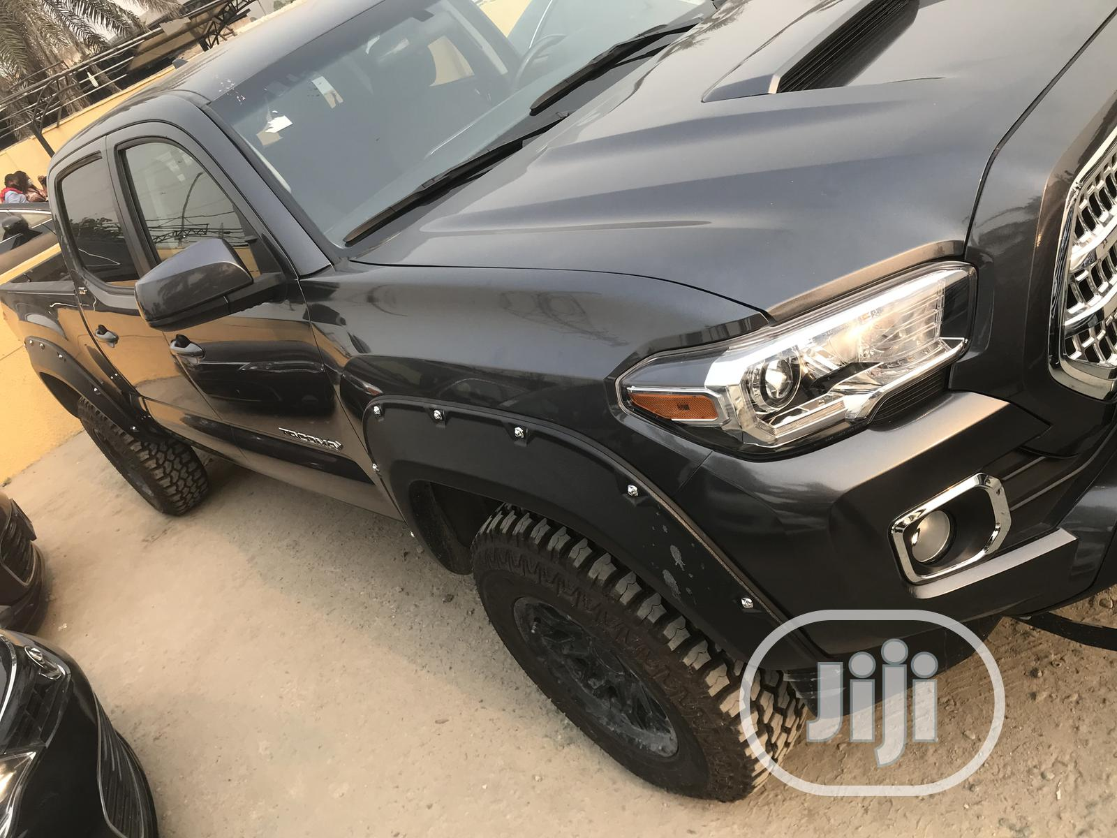Toyota Tacoma 2016 4dr Double Cab Black | Cars for sale in Ajah, Lagos State, Nigeria