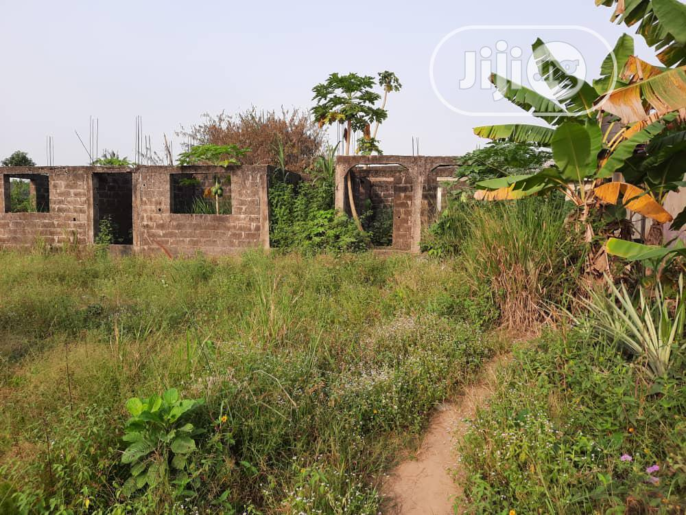 A Full Plot of Land With a Building on It for Sale.