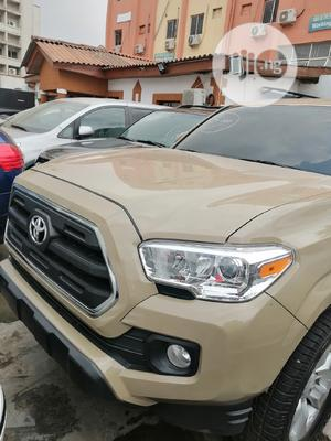 Toyota Tacoma 2016 4dr Double Cab Beige | Cars for sale in Lagos State, Ikeja
