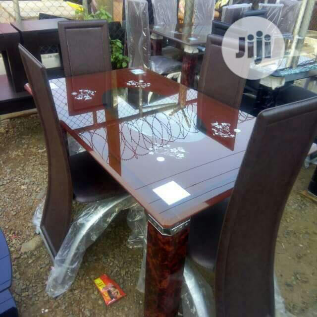 Set of Dining by Four Chairs