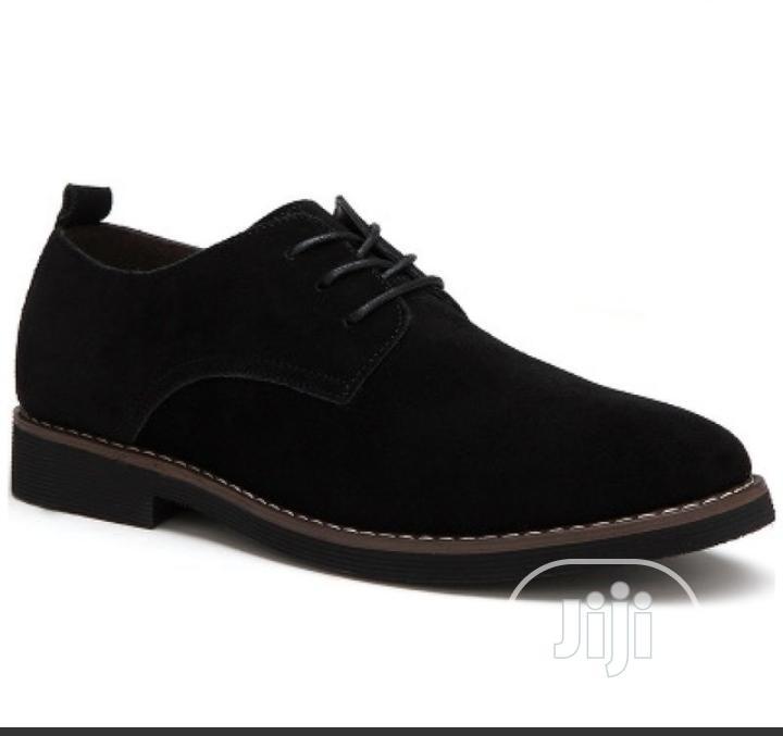Men Sued Shoe