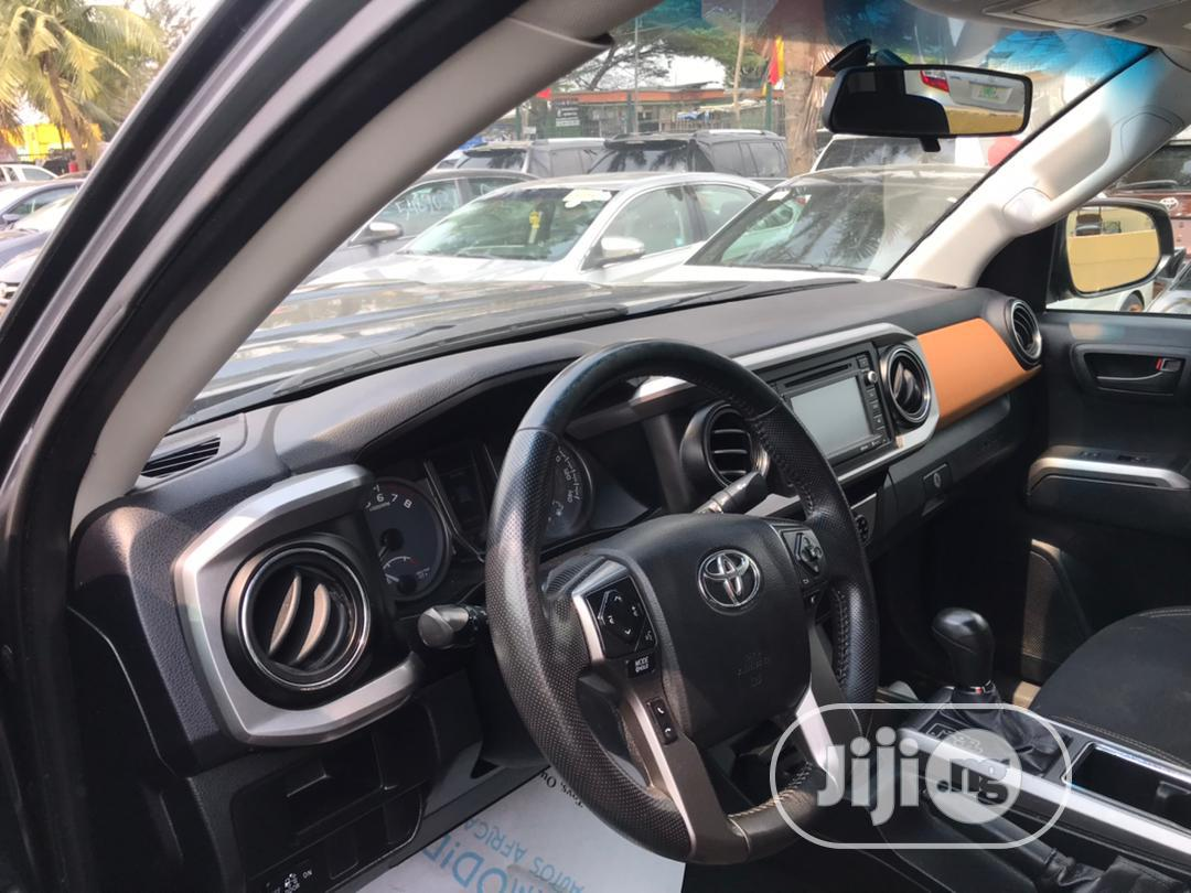 Toyota Tacoma 2016 4dr Double Cab Black | Cars for sale in Lekki, Lagos State, Nigeria