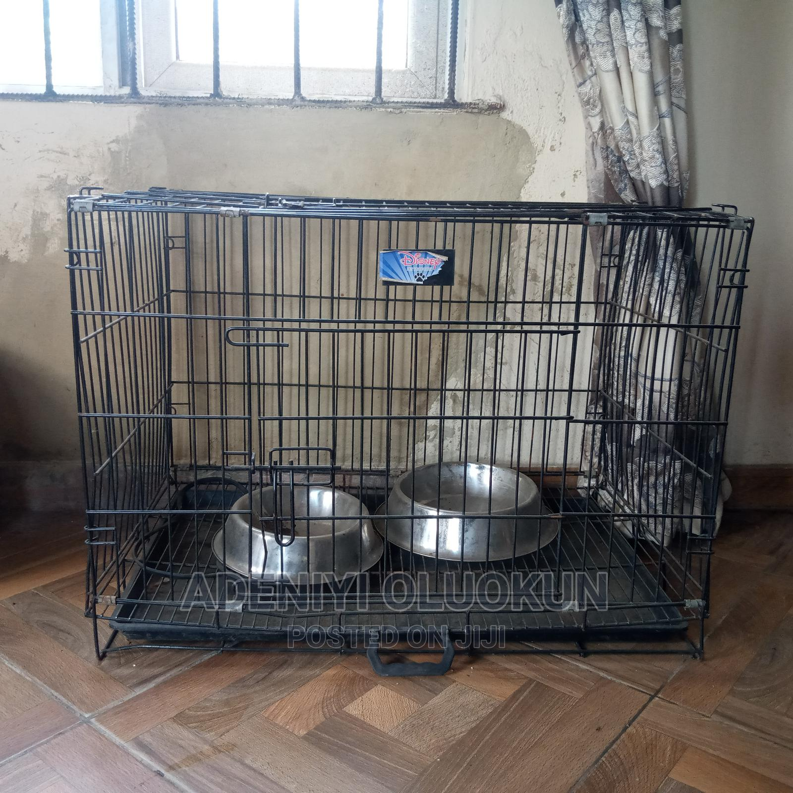 Archive: Medium Sized Collapsible Metal Dog Cage.