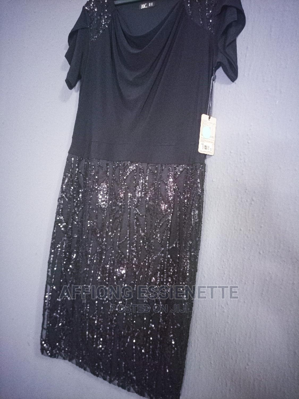 Archive: Black Turkey Dress