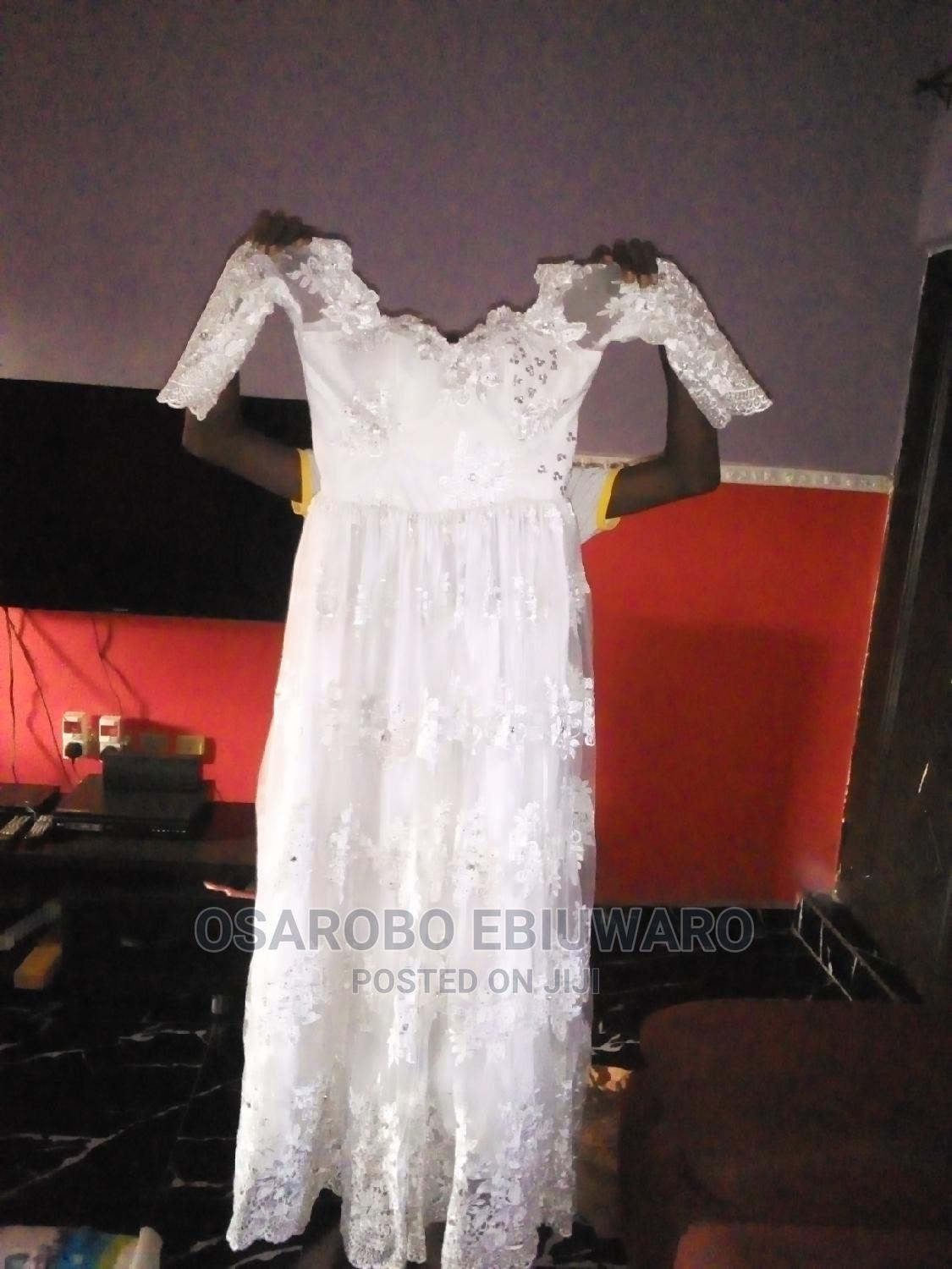 Archive: Fairly Used Wedding Gown
