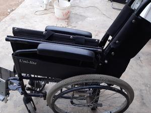 Uni-lite Collapsible/Foldable Wheelchair   Medical Supplies & Equipment for sale in Lagos State, Isolo