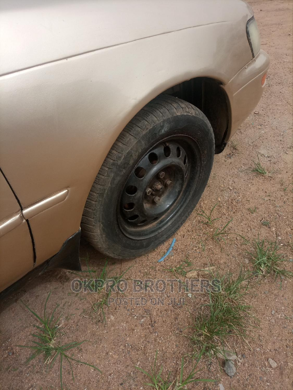 Archive: Toyota Corolla 1996 Sedan Automatic Gold