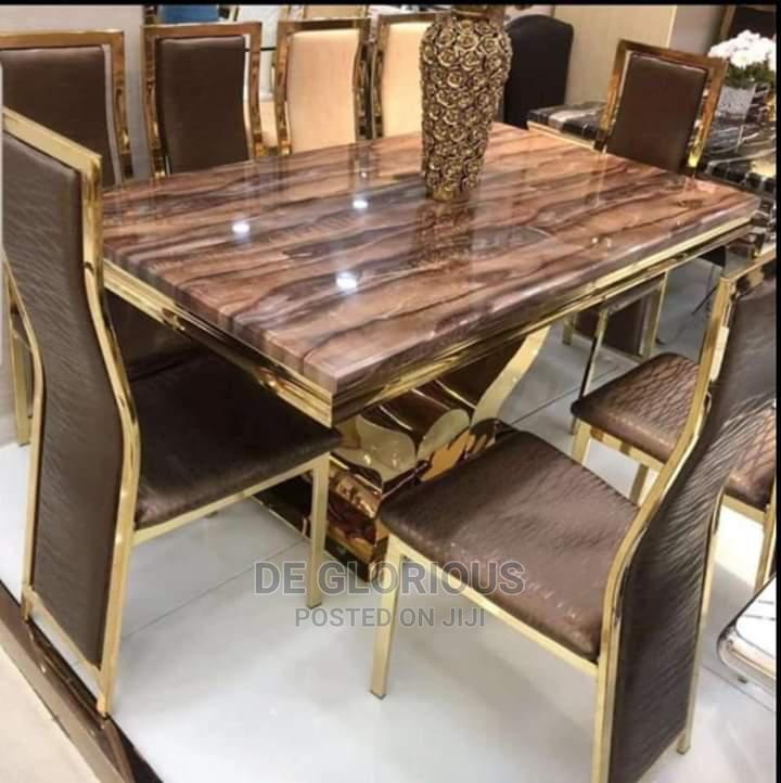 Gold Dinning by 6 With Brown Chair