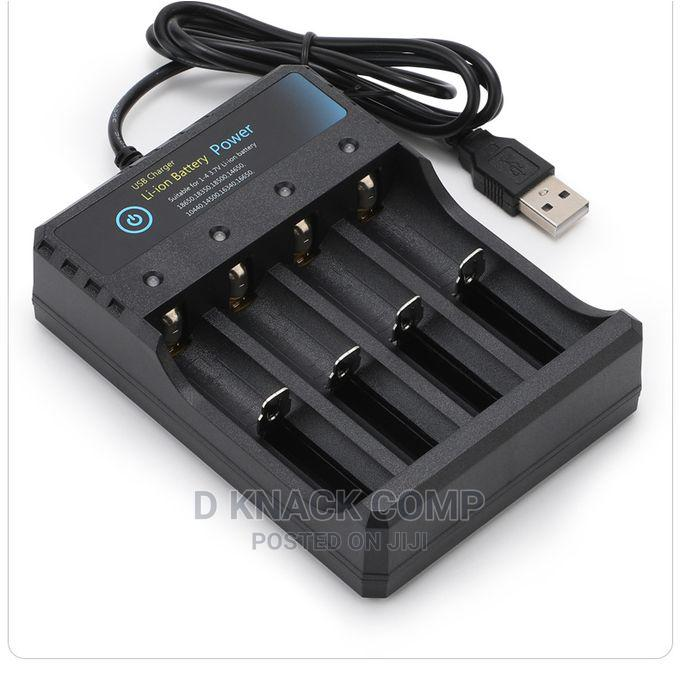 Lithium Battery Charger 4 Slot Universal USB Charging Stand   Accessories & Supplies for Electronics for sale in Ikotun/Igando, Lagos State, Nigeria