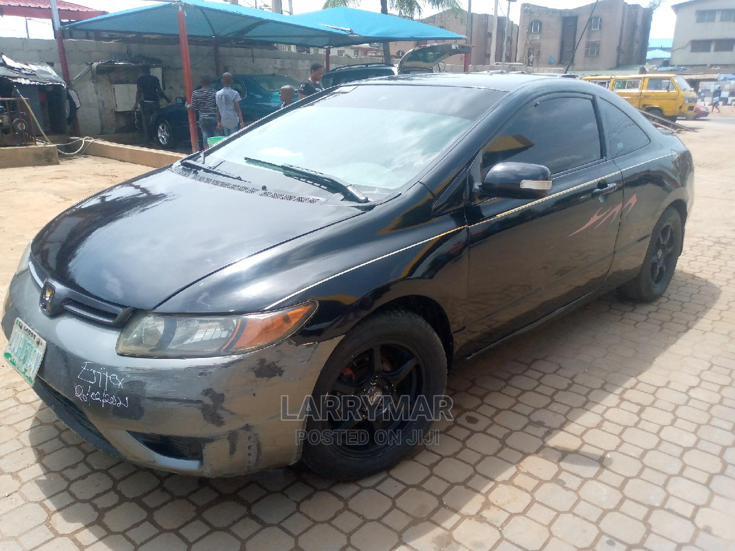 Honda Civic 2006 1.8 Coupe DX Automatic Black | Cars for sale in Ejigbo, Lagos State, Nigeria