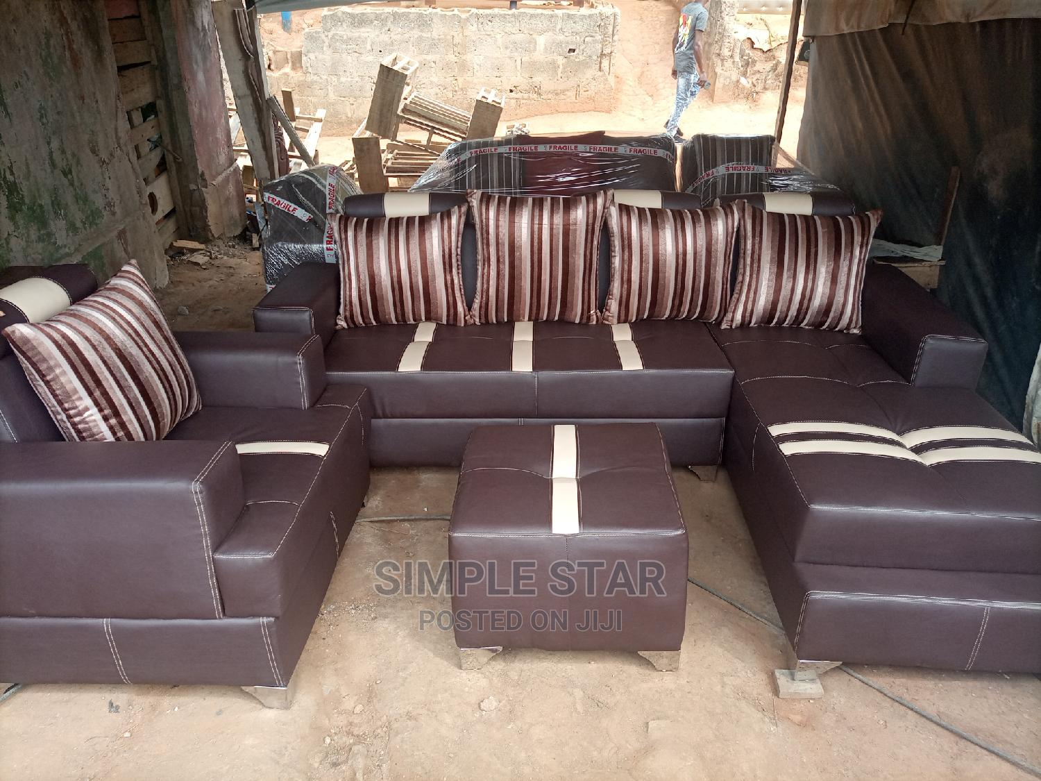 Archive: Brown Leather Sofa With a Single and Center Table