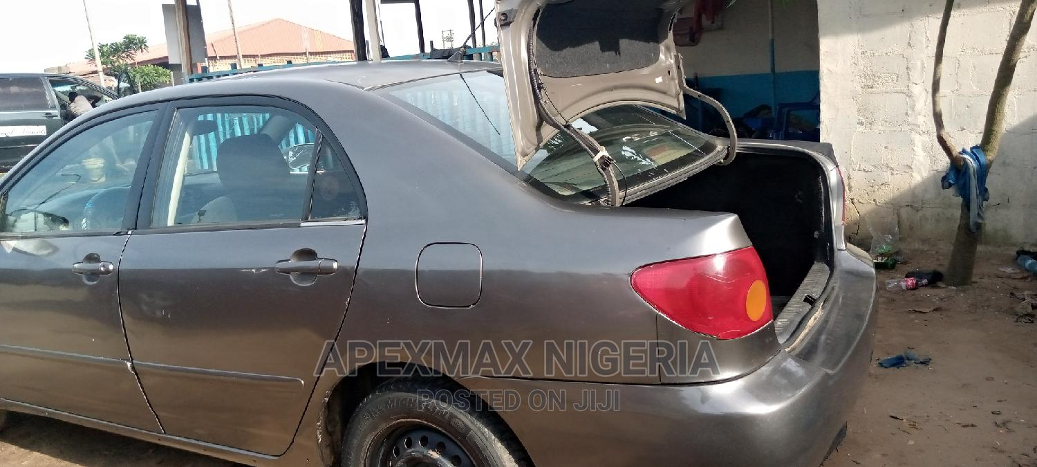 Toyota Corolla 2003 Sedan Automatic Gold | Cars for sale in Ojo, Lagos State, Nigeria