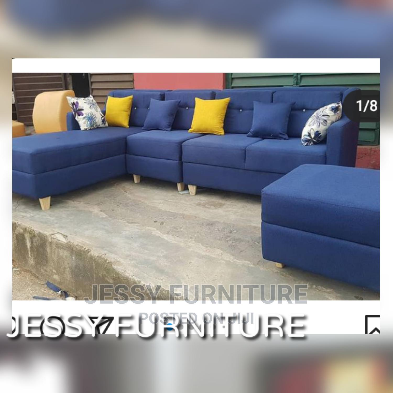 L-Shaped (7seater)Fabric Sofa With an Ottoman
