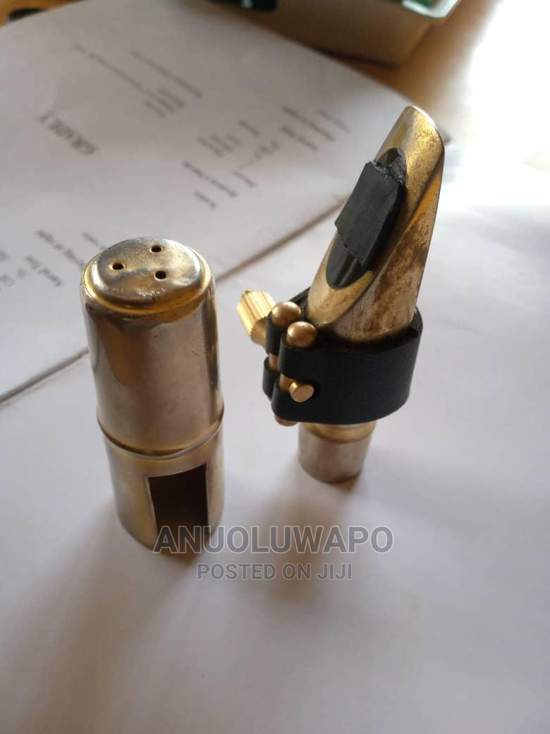 Archive: Metal Mouthpiece With Leather Ligature