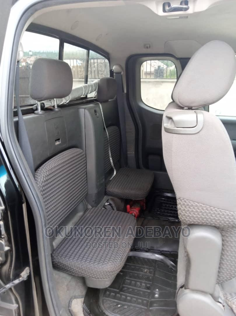 Archive: Nissan Frontier 2010 Crew Cab SE 4x4 Long Black