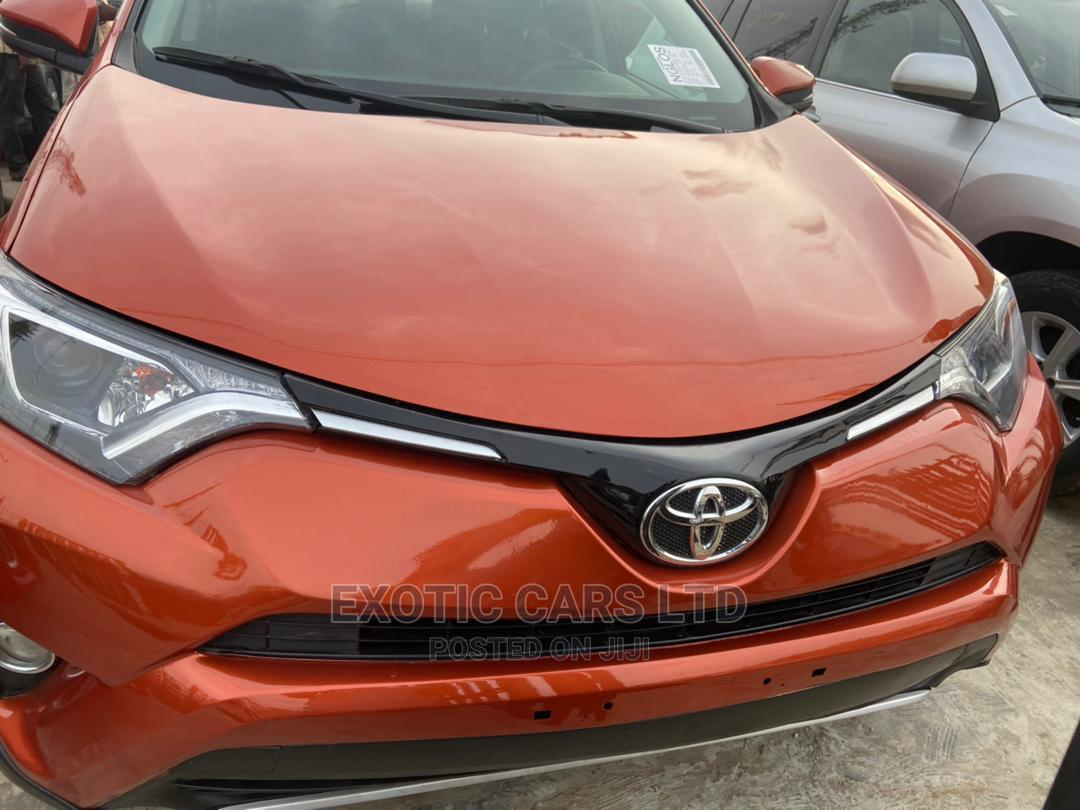 Archive: Toyota RAV4 2016 XLE AWD (2.5L 4cyl 6A) Orange