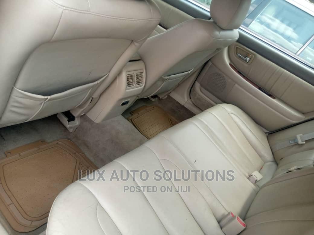 Archive: Toyota Avalon 2004 XL Gold