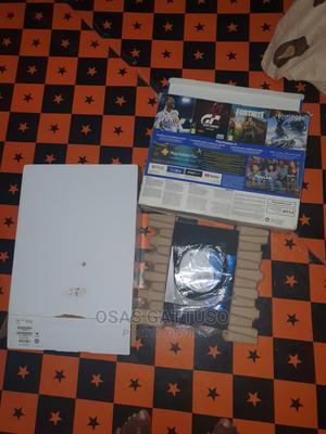 2 Months Old PS4 Slim Hacked v 6.72 500GB 9 Games 2 Pads | Video Game Consoles for sale in Edo State, Benin City