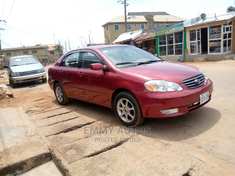 Archive: Toyota Corolla 2004 Sedan Automatic Red